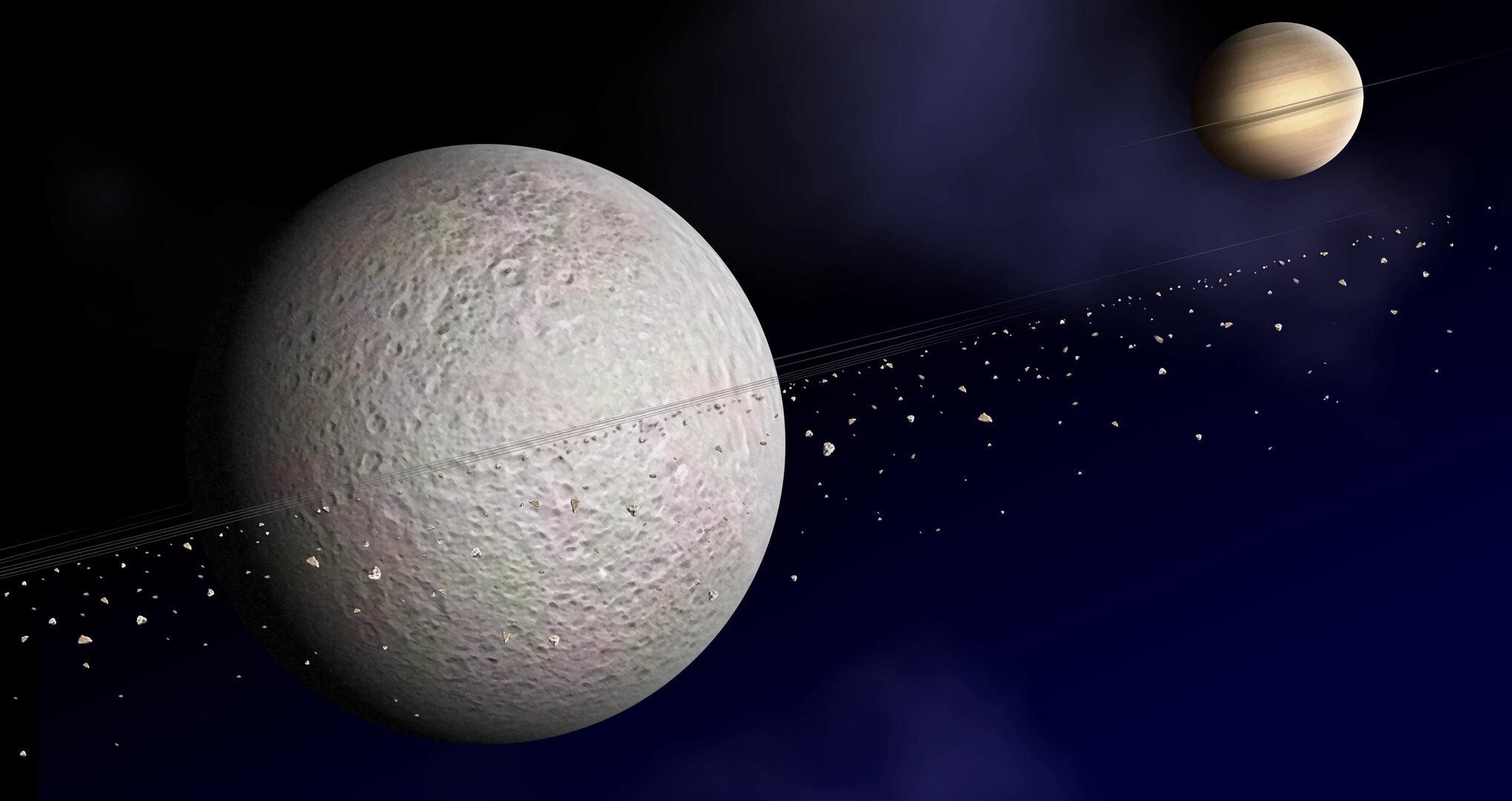 Satürn'ün Uydusu Rhea'nın Yüzeyindeki Tanımlanamayan Maddenin Gizemi Çözüldü.
